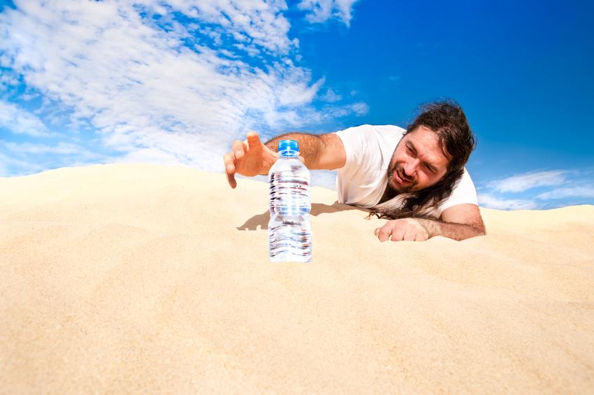 Thirsty man in the desert